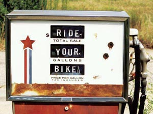"Old gas pump reading ""ride your bike"""