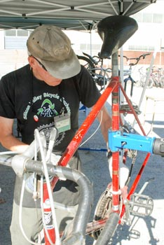 Man behind bicycle on repair stand