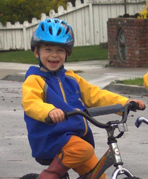 Smiling boy riding bicycle