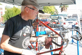 Man in work apron repairing a bicycle