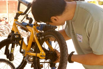 Man repairing a small bicycle